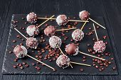 Homemade Chocolate Cake Pops Sprinkled With Crushed Candies And Coconut Sprinkles On A Black Stone T poster