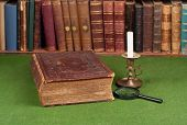 Antique Book, Candlestick And Magnifying Glass