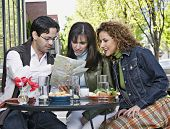 Hispanic friends looking at street map