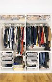 Colored Clothes In The Closet. Storage Of Clothes And Things In The Closet poster