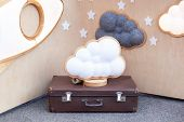 Cloud Lamp On Suitcase On Background Of Wooden Wall With Stars. Modern Home Decoration. Decorative C poster