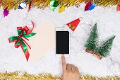 Online Shopping On Seasonal Gifts During Christmas Holiday. Woman Touch Mobile Phone Button Decorate poster