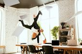 Young Caucasian Businessman Having Fun Dancing Break Dance In The Modern Office At Work Time With Ga poster