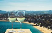 Two Drink Glass White Wine Standing On Background Blue Sea Top View City Coast Yacht From Observatio poster