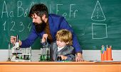 Teacher Man With Little Boy. School Lab Equipment. Student Doing Science Experiments With Microscope poster