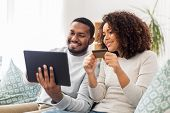 family, technology, online shopping and people concept - happy african american couple couple with t poster
