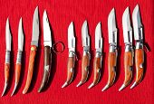 jackknife collection spain style wood handle on red background