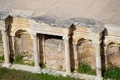 Antique Columns And Arches In The Hierapolis Amphitheater. Ancient Antique Amphitheater In The City  poster