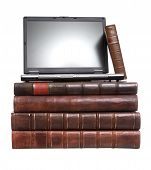 picture of leather-bound  - Old leather bound books with a laptop isolated on a white background - JPG