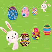 image of baby easter  - Easter bunny playful with painted eggs - JPG