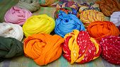 picture of rajasthani  - Colorful turbans for sale in Jaisalmer Rajasthan India - JPG