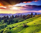 stock photo of meadows  - Majestic sunset in the mountains landscape - JPG