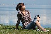 Sunbathing Girl On The Grass