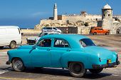 HAVANA-FEBRUARY 21:Old Buick with the lighthouse of El Morro in the background February 21,2013 in Havana.Thousands of these vintage cars are still used in Cuba and have become a touristic attraction