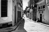 Grunge black and white image of a shabby street in Havana