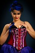 Girl In A Red Corset On A Dark Background