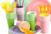 Multicolored plastic tableware close up