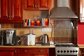 foto of kitchen appliance  - Kitchen with wooden cupboards and cabinets and appliance - JPG