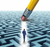 stock photo of maze  - Leadership Solutions with a businessman walking through a complicated maze opened up by a pencil eraser as a business concept of innovative thinking for financial success - JPG