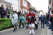 HASTINGS, ENGLAND - MAY 7: Musicians  parade through the Old Town during the annual Jack In The Gree