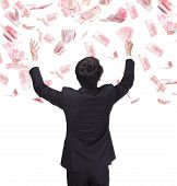 picture of bundle money  - happy business man hold China money  - JPG