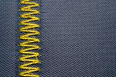 Yellow Zig-zag Sewing On Blue Fabric Background