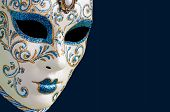 stock photo of incognito  - Isolated Blue Venetian mask on a blue background - JPG