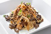 Rice spaghetti with mushrooms. Japanese food,
