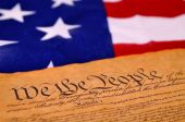 stock photo of preamble  - Preamble to the US Constitution with the stars and stripes in the background - JPG