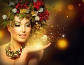 foto of gold  - Christmas Winter Woman with Miracle in Her Hand - JPG