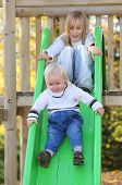foto of chute  - Funny kids playing on the chute - JPG