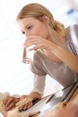 Blond office-worker drinking water at lunchtime