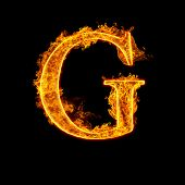 Fire alphabet letter G isolated on black background.