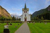 Small Church In The Slopes Of The Mountains In Norway