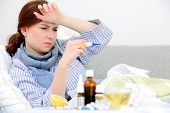 foto of high fever  - Sick woman lying in bed with high fever - JPG