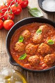 stock photo of meatballs  - meatballs with tomato sauce in black pan - JPG