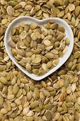 Pumpkin seed, healthy snack in heart shaped tray