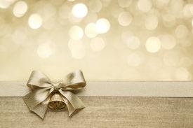 foto of ribbon decoration  - Golden ribbon bow with bokeh - JPG
