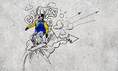 Close up of hand drawing sketches of snowboarder