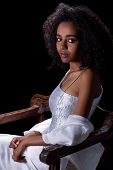 Young Ethiopian woman wearing a white traditional Ethiopian dress