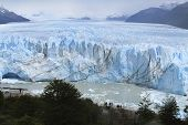 Glacier With Mountains And Lake. Argentina. Perito Moreno.