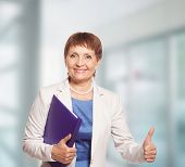 foto of 55-60 years old  - attractive woman 50 years old with a folder for documents - JPG