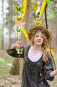 Picture Of A Pretty Girl In A Folk   Circlet Of Flowers Holding Garland Of Butterflies
