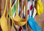 stock photo of food preparation tools equipment  - Set of kitchen tools hanging on the wall.