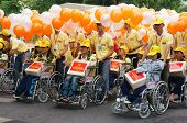 Handicapped People On Wheelchair At Community Activity