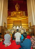 Ayuthaya, Thailand - 22 Nov 2013: Worshippers Pray Near The Statue Of Buddha In The Old Temple. The