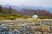 Spring landscape with tourist tent in the mountains. Mountain stream of melted snow. Carpathians, Uk