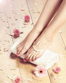 Summer spa background with a beautiful legs and flowers