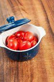 Small Cherry Tomatoes In Mini Cocotte. Closeup.