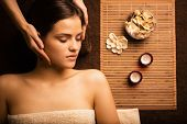 Young attractive girl in spa salon